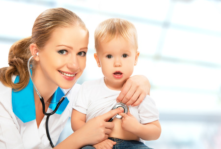 hearing protection: baby at the doctor pediatrician. doctor listens to the heart with a stethoscope