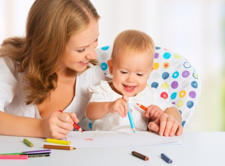 Mother and baby draw color pencil crayons photo