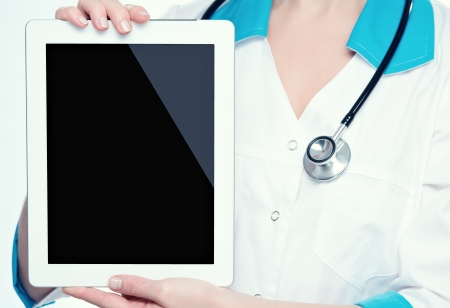 blank empty computer tablet in the hands of doctor photo