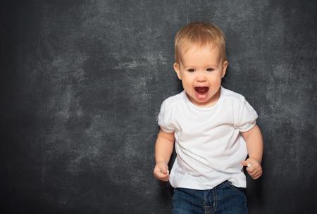 black baby boy: baby child and an empty Blackboard Stock Photo