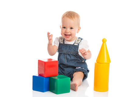 baby blocks: happy cheerful child playing with blocks cubes isolated on white background Stock Photo