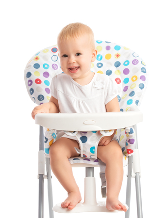 chairs: happy baby sitting in a high chair isolated on white background Stock Photo