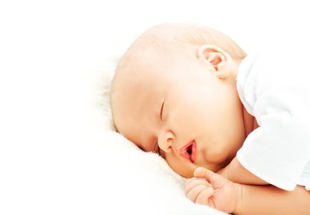 A cute newborn baby sleeps, rests