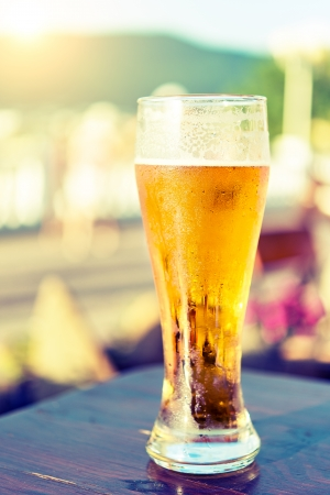 glass of beer on a table in a bar Stock Photo - 24475652