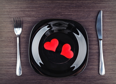 table setting for Valentines Day. plate, fork, knife and red heart