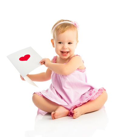 beautiful baby girl with cute valentine postcard with a red heart isolated on white background photo