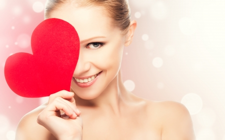 face of a beautiful young woman with red heart symbol of love