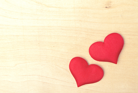 valentine card. two red hearts on a wooden board photo
