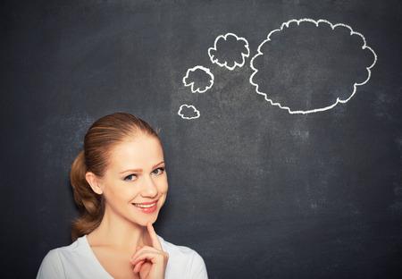 mixed race girl: woman think at a blank blackboard