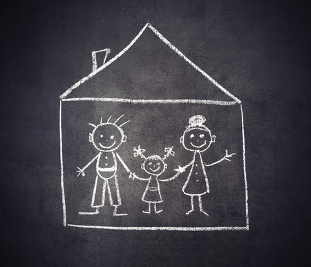 concept. family and home are drawn with chalk on a blackboard photo