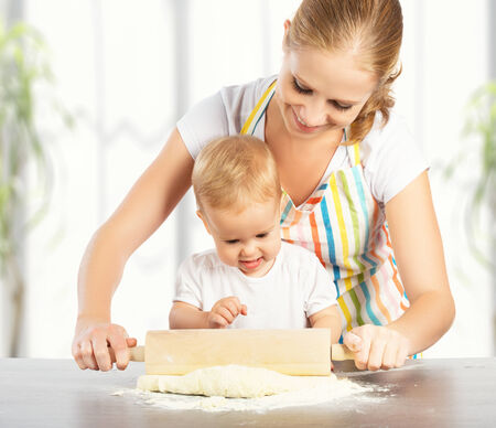 little dough: baby girl with her mother rolled out the dough cook, bake