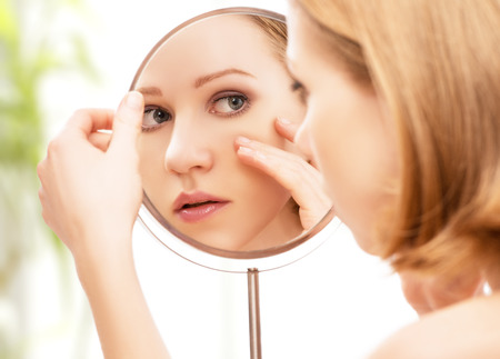 face of young beautiful healthy woman and reflection in the mirror Imagens