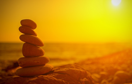 concept of balance and harmony. rocks on the coast of the Sea at sunset in the nature photo