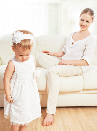 abuses: mother punishes abuses baby child daughter Stock Photo