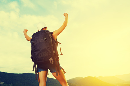conquer: happy camper conquer the mountain tops and enjoys success