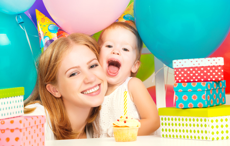 house party: happy childrens birthday. mother, baby daughter, balloons, cake, gifts