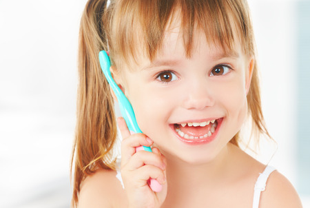 dental hygiene. happy little girl brushing her teeth Stok Fotoğraf