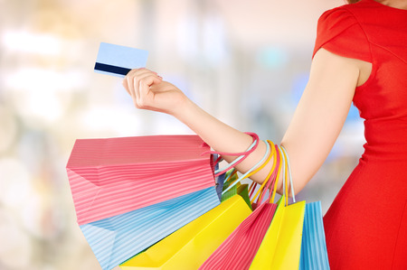 happy beautiful woman on shopping with bags and credit cards, christmas sales, discounts Stock Photo