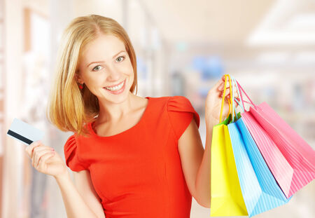 happy beautiful woman on shopping with bags and credit cards, christmas sales, discounts photo