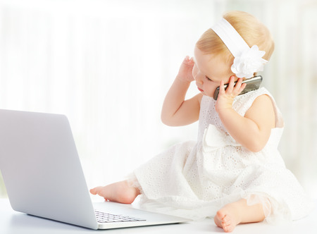 baby girl at a laptop computer, mobile phone