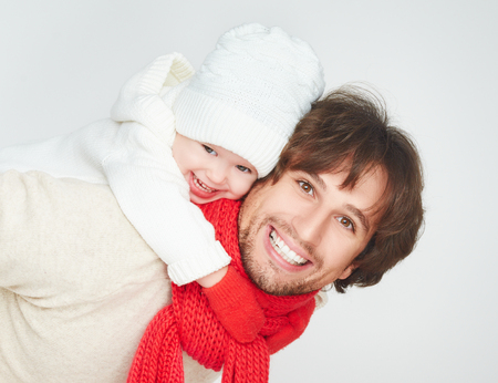 happy family in winter. father dad playing with baby daughter child girl photo