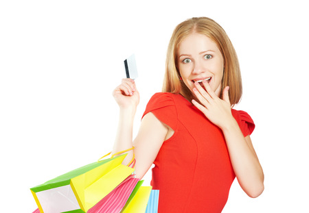 happy beautiful woman on shopping with bags and credit cards, christmas sales, discounts isolated on white photo