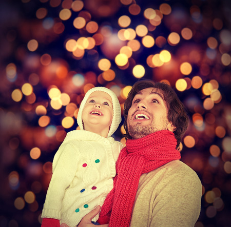 children celebration: happy family father and child baby daughter and a Christmas miracle