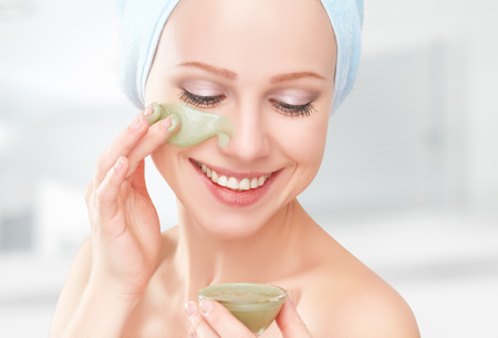 beautiful girl in the bathroom and mask for facial skin care photo