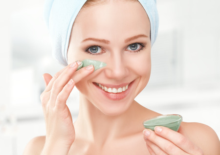 body mask: beautiful girl in the bathroom and mask for facial skin care