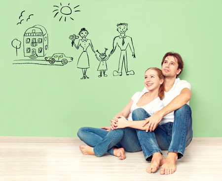 home insurance: concept. young happy family couple dreaming of new house, car, child, financial well-being