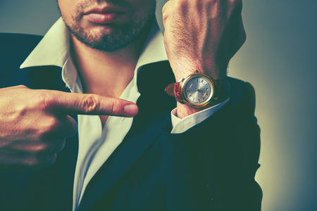 black clock hands: concept of time. watches on the arm of stylish businessman Stock Photo