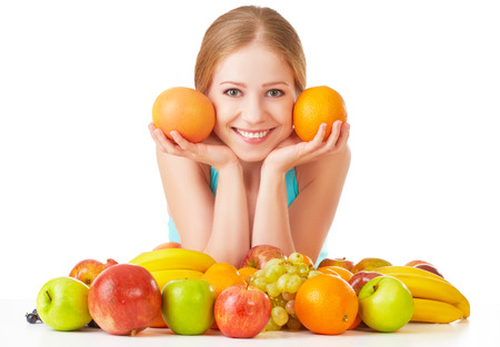 happy young woman and healthy vegetarian food, fruit Isolated on white background photo