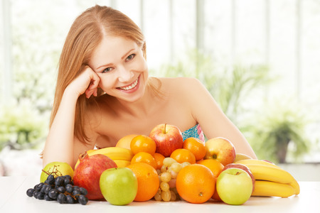 happy young woman and healthy vegetarian food, fruit photo