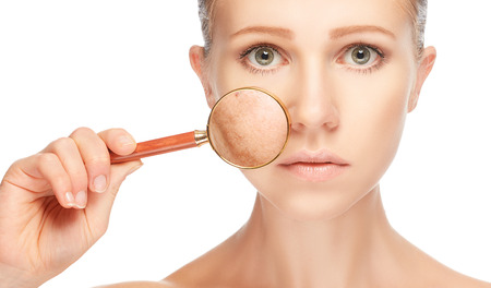 beautiful nude women: concept skincare. Skin of beauty young woman with magnifier before and after the procedure on a white background