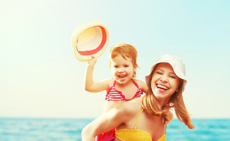 little girl beach: happy family on the beach. mother and baby daughter  at sea Stock Photo