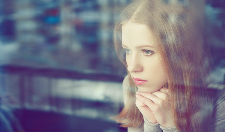young teen girl nude: alone thoughtful sadness girl is sad at the window