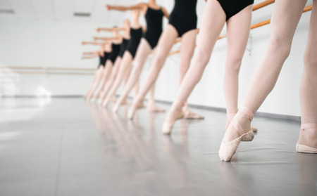 legs of young dancers ballerinas in class classical dance, ballet Banco de Imagens