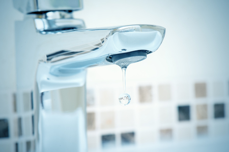 water dripping: water tap and water dripping from it Stock Photo