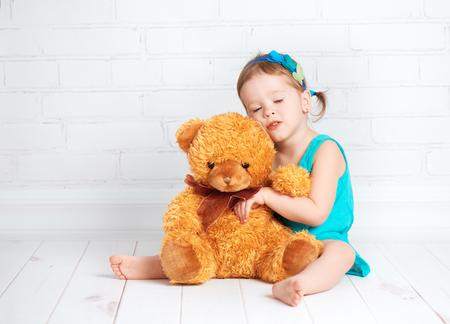 teddybear: little girl baby hugging a loved teddy bear Stock Photo
