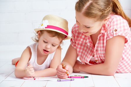 mother and baby daughter together paint a kid pencils photo