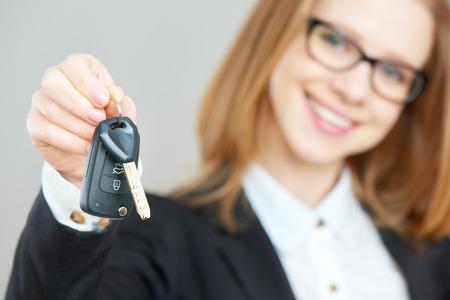 car loan: The business happy woman holding car keys