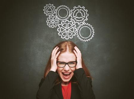 ストレス。女性頭痛と強調しました。黒板について黒板概念若い女性 写真素材