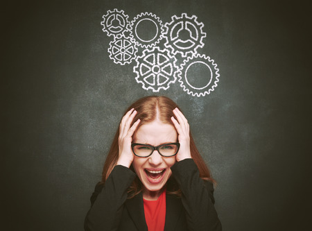 Stress. woman stressed with headache. Blackboard concept young female about blackboard