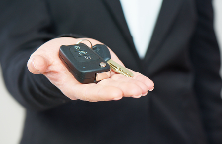 the car keys in hand men businessman photo