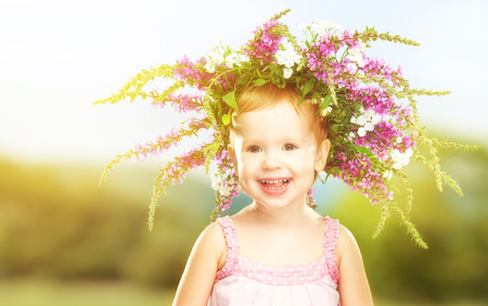 smile face: face happy little baby girl child in summer wreath