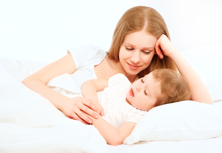 The happy family mother and baby sleeping in bed Stock Photo