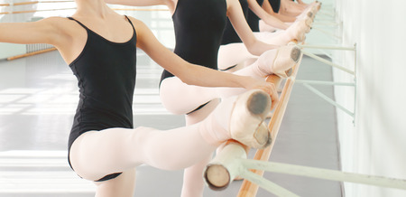 ballet slippers: legs of young dancers ballerinas in class classical dance, ballet Stock Photo