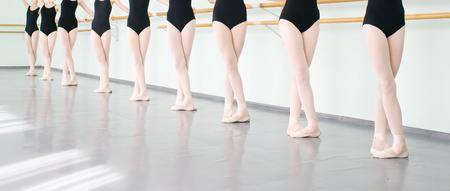 ballet shoes: legs of young dancers ballerinas in class classical dance, ballet Stock Photo