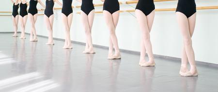 legs of young dancers ballerinas in class classical dance, ballet Foto de archivo