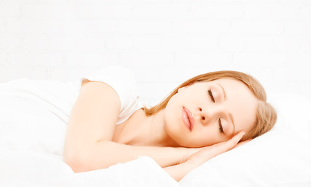 The Healthy young beautiful woman sleeping in white bed